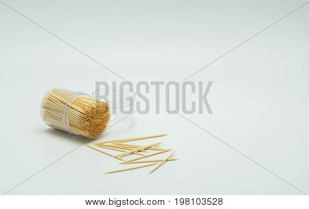 Toothpicks in a clear plastic bottle. And some fell on the floorToothpick slant Toothpick splatter