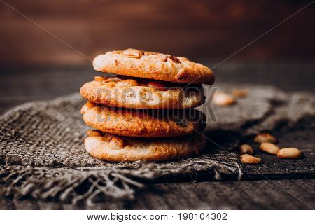 Stack of homemade peanut cookies on rustic wooden table background. Food baking. Copy space