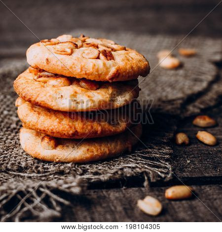 Close up Oatmeal Cookies with peanuts on dark wooden background table. Top view close up copy space