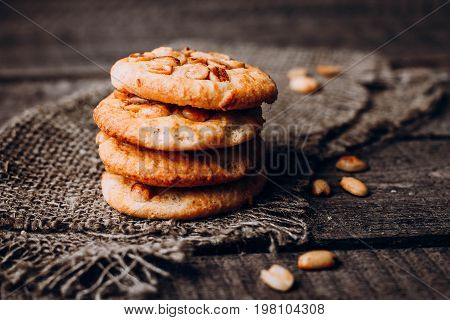 Stack of peanut cookies on rustic wooden table background. Food baking. Copy space