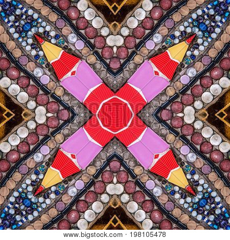 Colorful abstract kaleidoscope or endless pattern mosaic from broken tile and stone decorating on the wall for background.