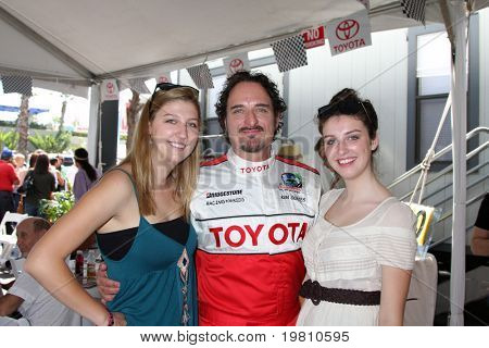 LOS ANGELES - APR 16:  Kim Coates and Daughters attends the Toyota Grand Prix Pro Celeb Race at the Toyota Grand Prix Track on April 16, 2011 in Long Beach, CA.