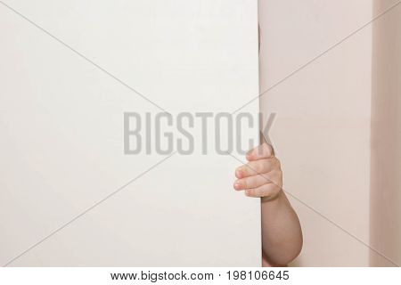 Violence over child concept. fear. Hide and seek in the photo cabinet for your design.