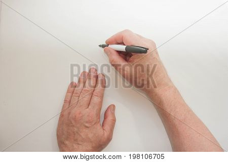 Hand And Marker. Man's Hand Write