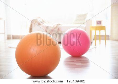 Rubber balls on floor indoors