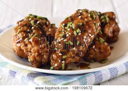 Cooked teriyaki chicken wings with sesame seeds