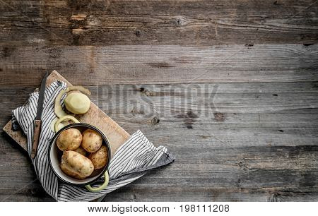 young potatoes sitting on cutting board, topview