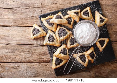 Hamentashen Triangular Cookies With Poppy Seed For Purim Holiday Close-up. Horizontal Top View