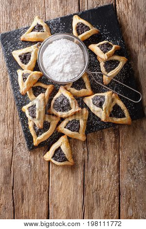 Hamentashen Triangular Cookies With Poppy Seed For Purim Holiday Close-up. Vertical Top View