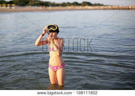 Little Girl In Swimsuit With Diving Mask While Playing