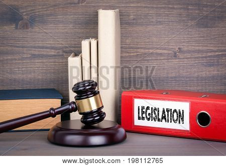 Legislation. Wooden gavel and books in background. Law and justice concept.