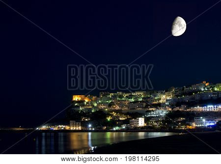 Peschici Gargano Apulia Italy: night image with moon lights and reflections