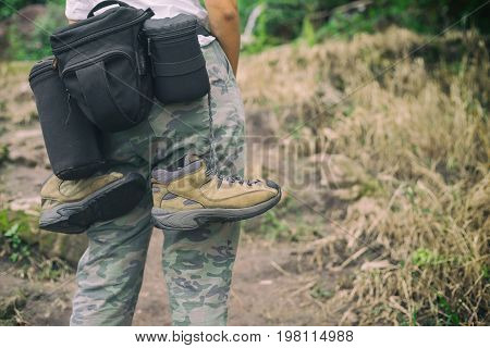 photographer hiking walking with backpack and camera in mountains travel concept hiking concept
