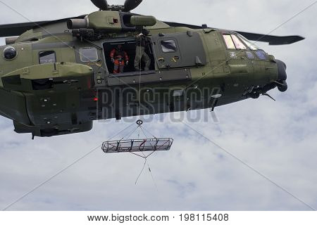 Kattegat Sea - Denmark July 22 2017: Royal Danish Air Fore rescue helicopter M-514 conducting a rescue exercise on ferry Margrete in Kattegat Sea on its way to Laesoe island in Denmark.