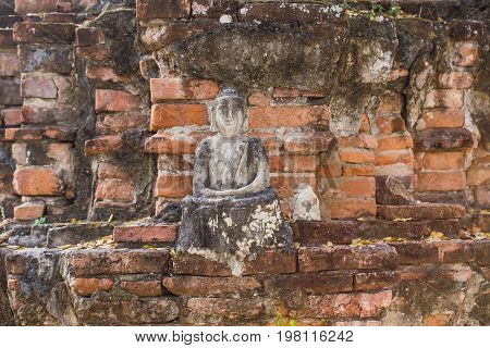 Brick Ancient Buddha Is Broken. Old Buddha Meditation. Buddha Statue Has Destroy Happy Smile Face.