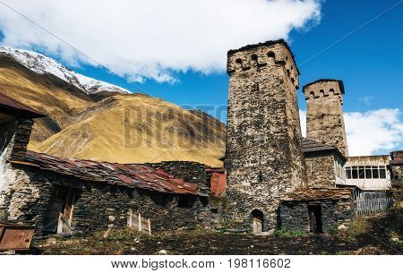 Traditional ancient Svan Towers and machub house with flagstone in Ushguli village Upper Svaneti Georgia. Georgian landmark