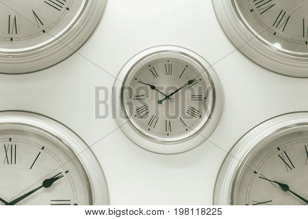 White Multiple Times Clock Hang On The Wall Timing Or Pass Memory Background Concept.