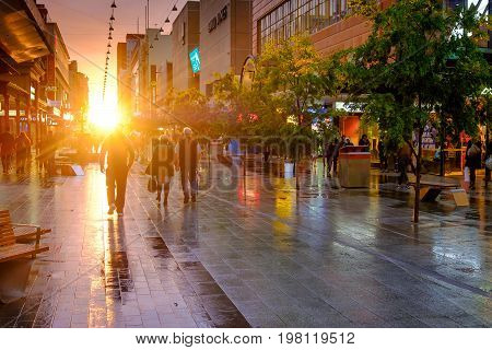 Adelaide Australia - September 30 2016: People walking along the Rundle Mall in Adelaide CBD at sunset viewing towards West. Rundle Mall is the premier shopping area of South Australia