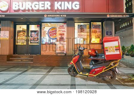 SEOUL, SOUTH KOREA - CIRCA MAY, 2017: Burger King delivery motorbike in Seoul. Burger King is an American global chain of hamburger fast food restaurants.