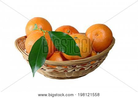 Tangerine fruits in bamboo basket isolated on white background