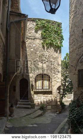 Narrow street with ancient houses at beautiful little village Bonnieux in Provence France