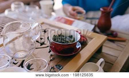 Pouring Chinese Green Tea Into Gaiwan With Hot Water. Chinese Authentic Tea Ceremony
