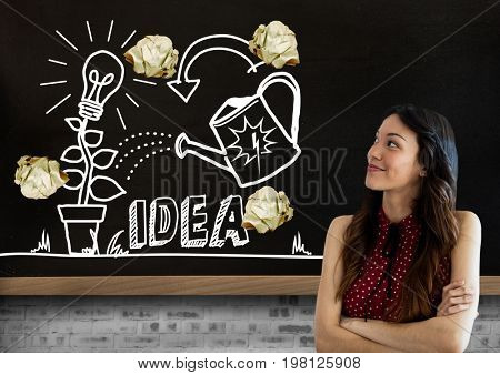 Digital composite of Woman standing next to light bulb and ideas drawings garden with crumpled paper balls  in front of b