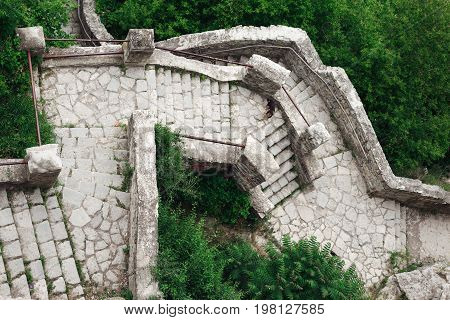 Top view of an old stone staircase.