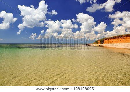landscape coastline with crystal clear water and clay cliffs in the background Water ripples in the wind