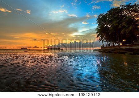 Beautiful sunset over sea with colorful sky background at the shore during low tide in the beach.Copy space conceptual.