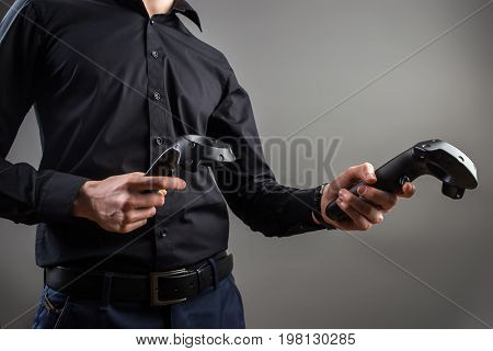Virtual Reality Headset On A Man With Video Game Controller