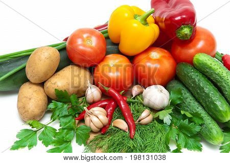 Vegetables and greens on a white background. Horizontal photo.