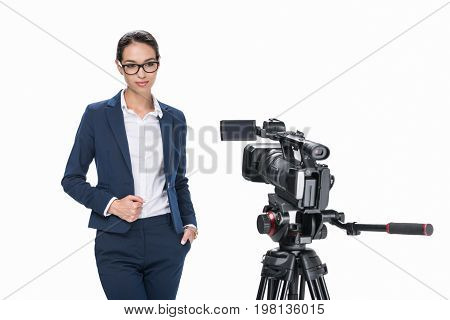 Attractive Female Newscaster Standing In Front Of Camera, Isolated On White