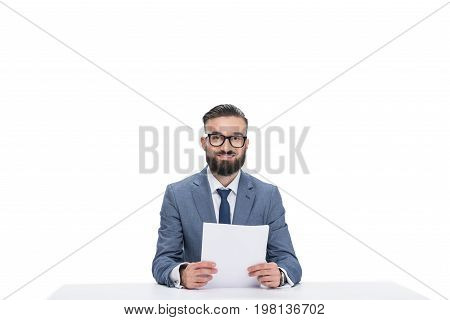 Smiling Male Newscaster With Papers Looking At Camera, Isolated On White
