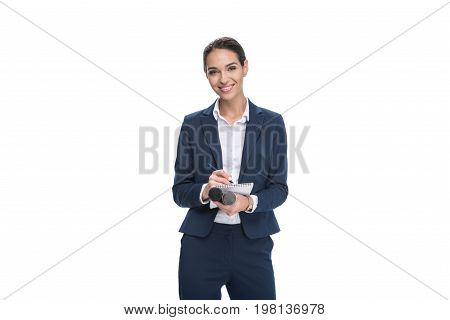 Smiling Female Journalist In Suit With Microphone Writing In Notepad, Isolated On White