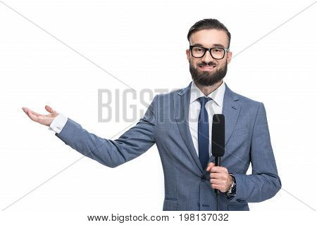 Handsome Smiling Male Journalist With Microphone Presenting Something, Isolated On White