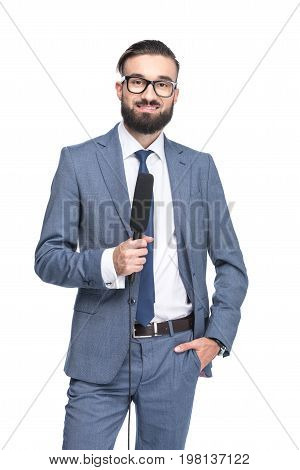 Handsome Anchorman In Suit Holding Microphone, Isolated On White