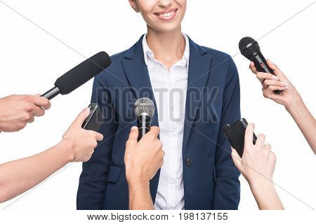 Cropped View Of Journalists With Microphones Interviewing Smiling Businesswoman, Isolated On White