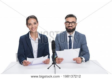 Smiling Newscasters With Papers And Microphone Looking At Camera, Isolated On White