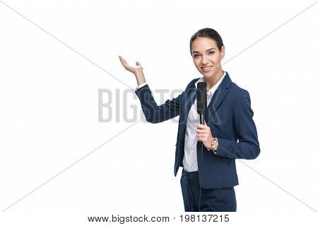 Smiling Female Newscaster With Microphone Presenting Something, Isolated On White