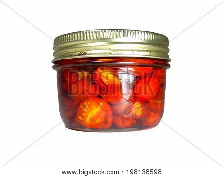 Jar of sun dried tomatoes preserved in olive oil in a sealed glass jar, isolated on a white background