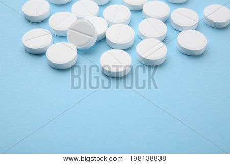 Health care concept. Pills on blue background