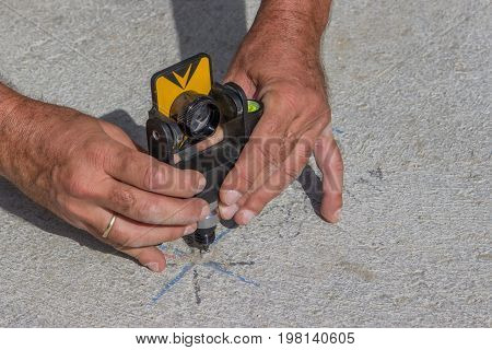 Total Station Prism With Survey Worker Hands