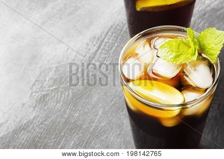 Two Glasses Of Cocktail Cuba Libre On A Dark Background. Copy Space. Food Background