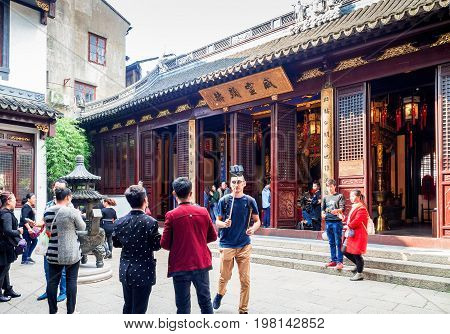 Shanghai, China - Nov 6, 2016: Inner courtyard of the 600-year-old Old City God Temple, where another prayer house resides. The surrounding is bustling with visitors.