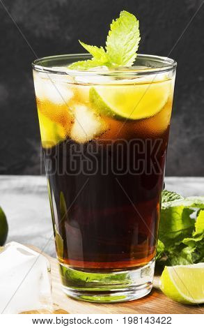 Cocktail Cuba Libre In A Glass On A Dark Background