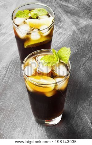 Two Glasses Of Cocktail Cuba Libre On A Dark Background