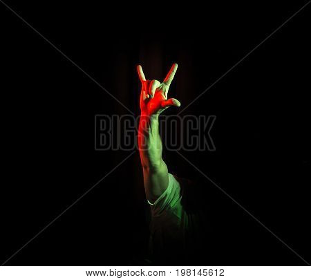 Rock & roll heavy metal sign horns on a black background party hard