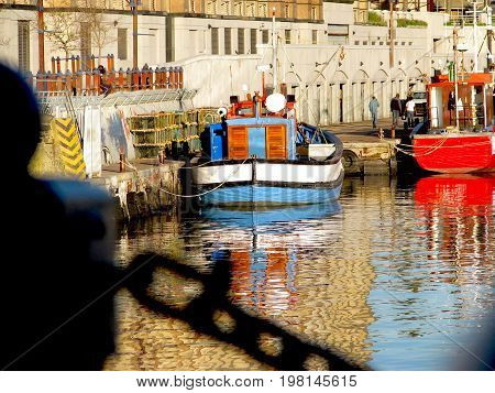 FROM VICTORIA AND ALFRED WATERFRONT,  CAPE TOWN, SOUTH AFRICA, VIEW OF BOATS  REFLECTING ON THE WATER
