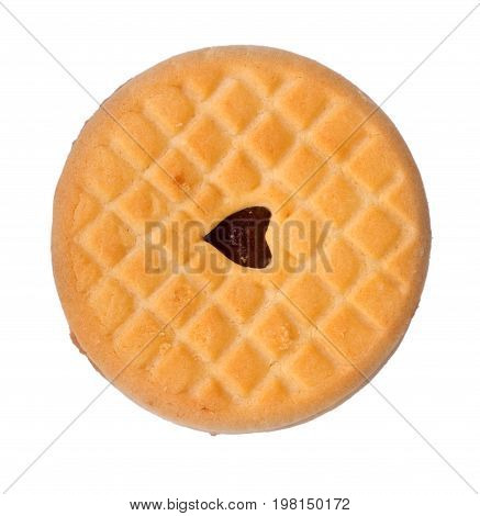 A delicious, sweet and homemade sandwich cookie with berry cream, isolated on a white background. Single biscuit with strawberry jam. Tasty bakery and flour products.